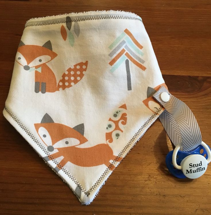 Bandana Bib with pacifier or teether holder   https://www.facebook.com/BibStyle/