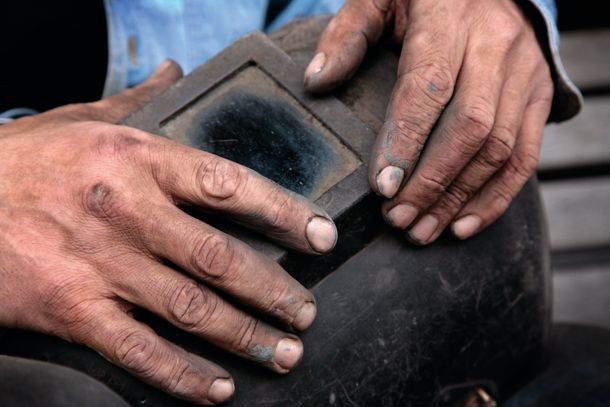 Concentrating on a small part of your subject can often have a much more profound effect on the viewer and say more than the bigger picture.    This welder's grubby hands make for a great example of how spotting and picking out the essence of a character pays off.    Cropping in so tight can sometimes be daunting