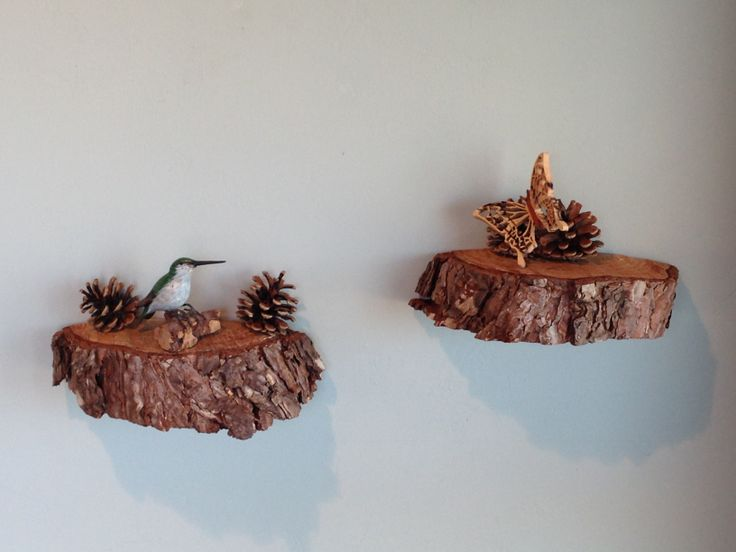 DIY wall shelves from evergreen tree trunk slices. This usage is fugly but like the concept for flaming small walls on either side of front door