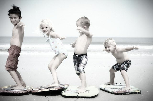 When I have kids, I'm going to have them looking just like these goofballs. Except they'd be on surf boards, not boogie boards.