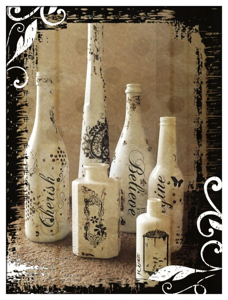 I spray painted bottles white. Added 'rub on' words. Makes great table decorations throughout the year. At Christmas time I place holly berries, poinsettia flowers and candles in bottles. During the year I would use seasonal flowers in the bottles