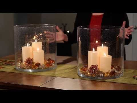This video is from Canada but you can get this product in UK too.  PartyLite Canada Decorating With the Majestic Hearth Hurricane
