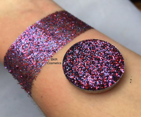 Holographic valentine pressed glitter eyeshadow, cosmetic grade glitter, glitter eyeshadow, pressed glitter, eyeshadow, glittery, sparkly Shade: valentine is a purple/red mix Pictures show glitter swatches with and without a flash. All photos are unedited. Do you love glitter make up