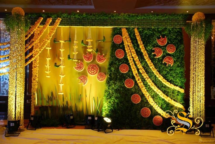 Indian wedding backdrop ideas with natural flower & green leaf