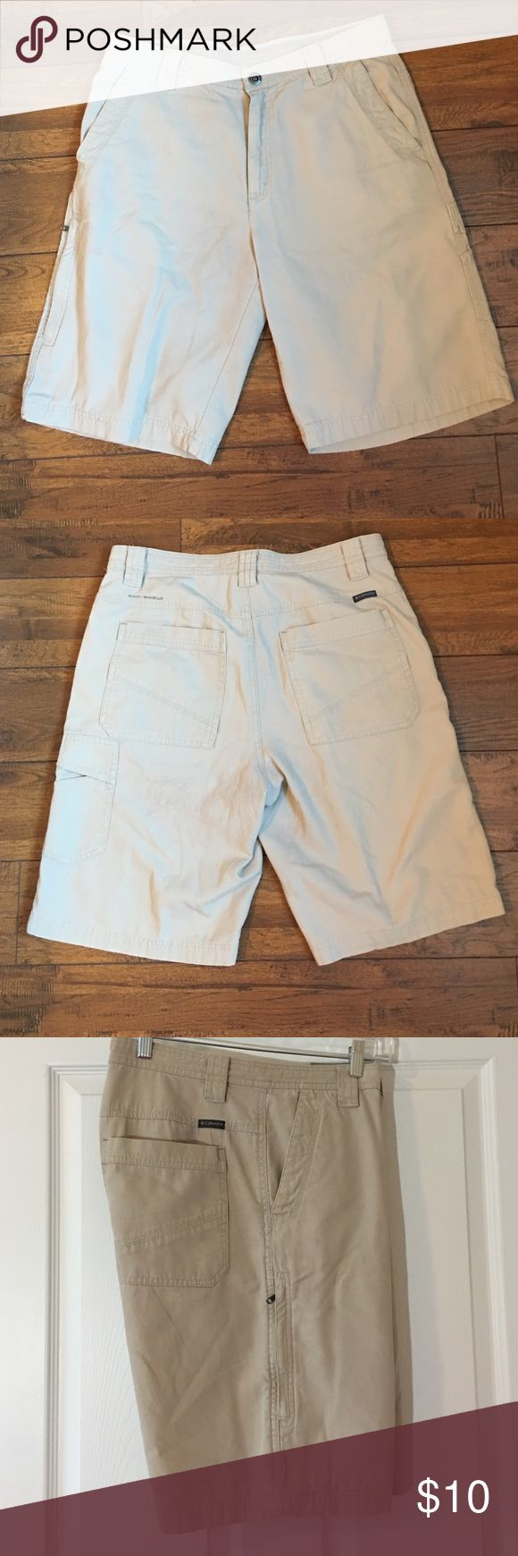 """Columbia hiking shorts. Hiking shorts with lots of pockets. Good condition. One light stain as seen in pic #4. 11"""" inseam. Columbia Shorts Cargo"""