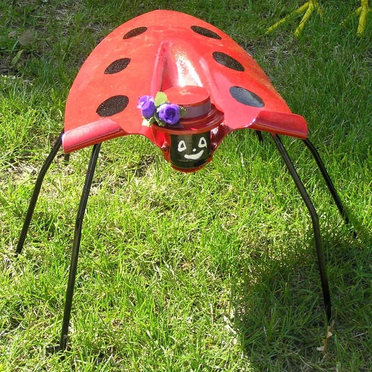 Shovel lady bug lawn ornament