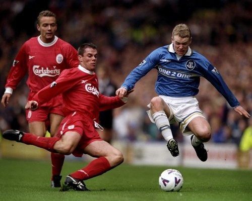 Carra about to clatter into Everton's Michael Ball during another hostile Merseyside derby