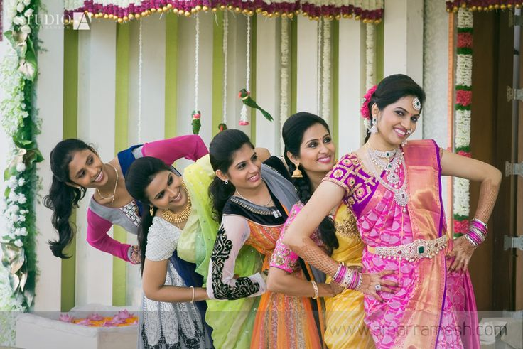 South Indian bride. Purple Kanchipuram silk sari. Braid with fresh flowers.Temple jewelry. Tamil bride. Telugu bride. Kannada bride. Malayalee bride. Hindu bride.