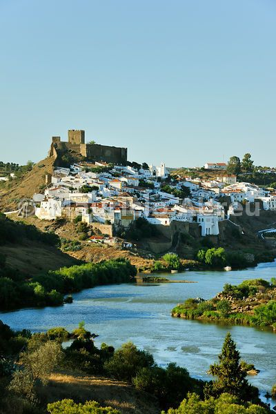 (The historical village of Mértola, overlooking the Guadiana river. Guadiana Valley Natural Park, Alentejo, Portugal