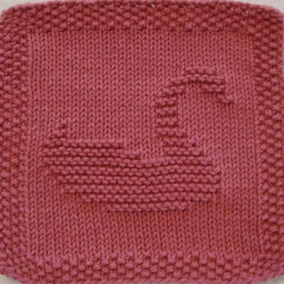 Swan No. 1 Knit Dishcloth Pattern This elegant swan glides gently along. She is designed in profile facing to the right with her head held high curving up to the right and her tail curving up to the left.