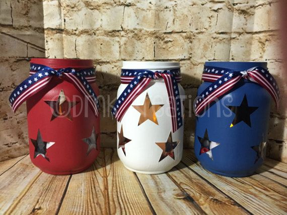 Set Of Patriotic Painted Mason Jar Tea Light Candle Holders Set of 3 jars Red, white and blue with stars. Please note actual color may vary from photos due to the resolution of your computer, tablet, and phone screens. 16 oz 5 inches tall painted mason jar. (pint size) Color..Red, White, and Blue Each jar is hand painted with 3 to 5 coats and a coat of matte sealant. Each jar comes with ribbon, candle, and beans. (Ribbon may be different from the pictures. It depends on what is availabl...