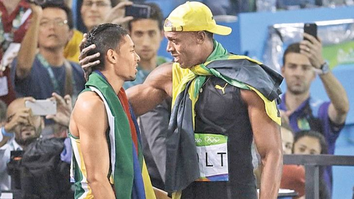 Usain Bolt congratulates Wayde van Niekerk after he broke Michael Johnson's 400m world record.