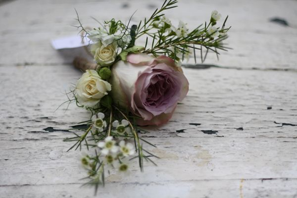 grooms button hole with memory lane rose and rustic bits