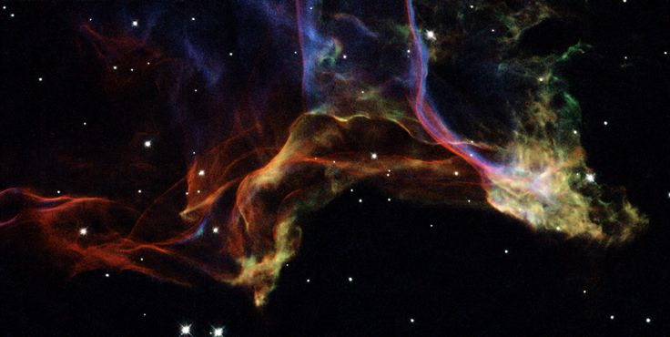 This is a small portion of the Veil Nebula — the shattered remains of a supernova that exploded thousands of years ago.     http://hubblesite.org/newscenter/archive/releases/nebula/2007/30/