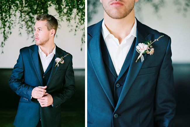 Navy groom's suit details and boutonniere by The Green Dandelion.