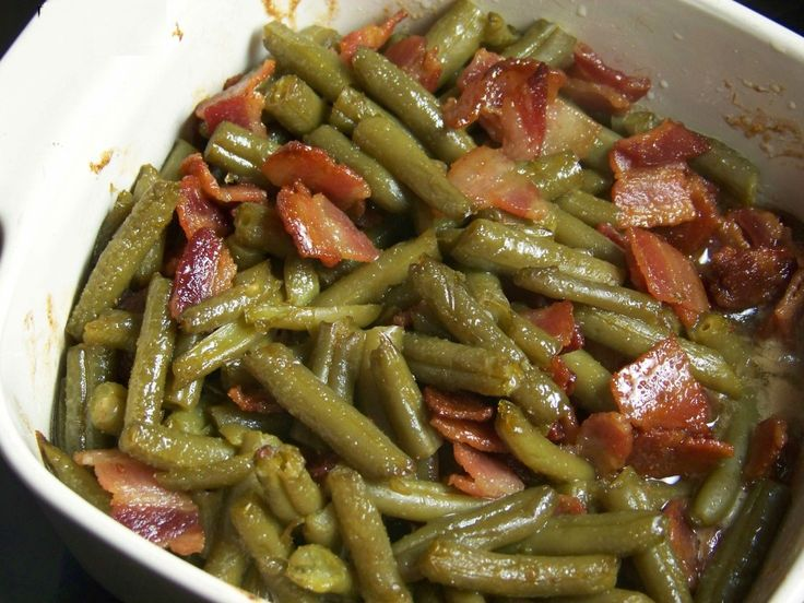 Arkansas Green Beans  3 cans green beans, 4 slices fried and diced bacon 1\2 cup brown sugar, 1\2 cup butter, 1/2 tsp garlic powder,1tsp soy sauce. Melt butter,add sugar, garlic powder, and soy sauce. Add beans and bacon. Refrigerate overnight. Bake at 350 degrees for 30 to 45 minutes.