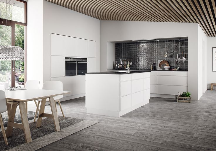 Create contrasts in your kitchen. A dark worktop is an obvious choice for a white Mano kitchen, in this case beech black composite. Mano's modular solutions let you customise a veritable food workshop, reminiscent of a professional kitchen. Exploit the many features used by chefs – e.g. more than one oven, perhaps including a steam oven, or boiling water on tap.The extra deep drawers provides you with more space on your worktop.