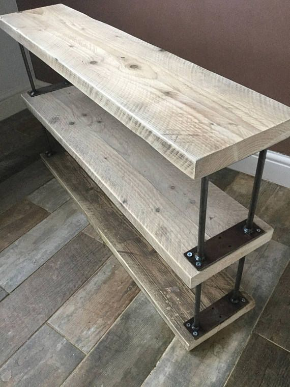 This is a beautiful rustic handmade shoe rack made from reclaimed scaffold boards beautifully complimented with steel acro style steel uprights. This shoe storage unit is available in three different widths and can be made higher if you would like more shelves adding to your shoe