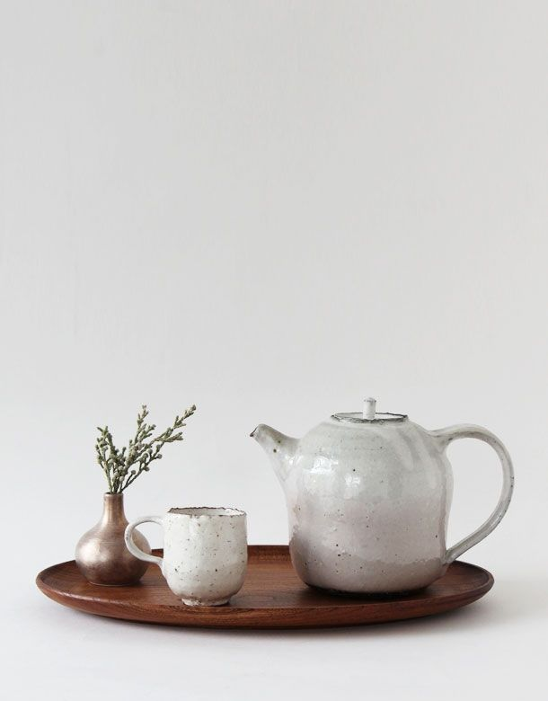 Ceramic tea pot , cup and silver coated vase