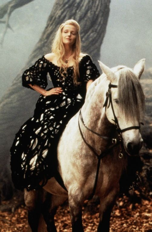 Light/dark - Miranda Richardson in Sleepy Hollow. The black/white against shades of grey pops her from the background. Emphasised by grey horse.