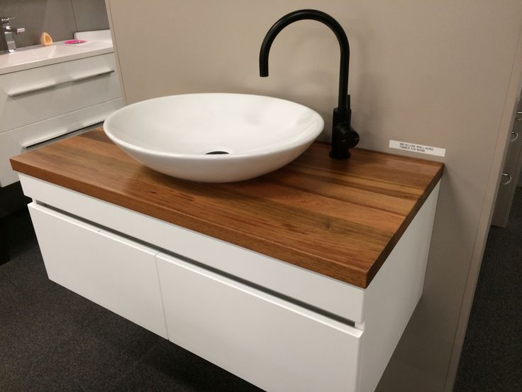 New Rifco allure vanity with solid timber top, Phoenix matte black tap, and black pop down.