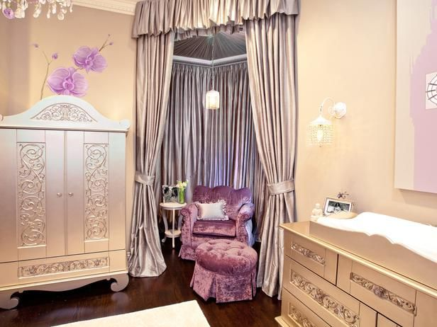 Warm neutrals and lavender with a hint of sage green set the calm color palette for the room, while dramatic silk dupioni draping creates a cozy and private seating area for rocking baby.