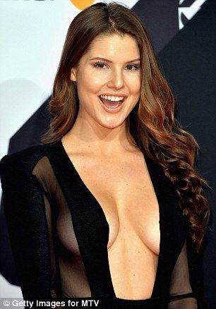 Brunette beauty: Wearing her long chestnut mane loose and in slightly tousled waves, the s...