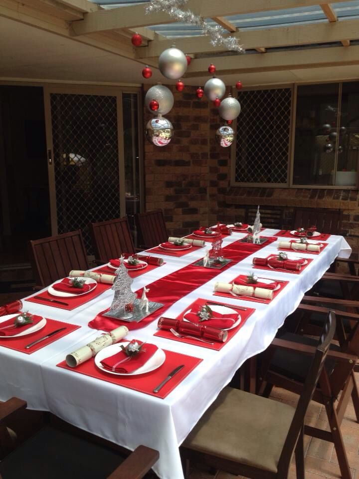 Christmas table setting. Made tablecloth, serviettes, serviette decorations, and hanging table centerpiece decoration myself! Red and white. Hand made. With love!