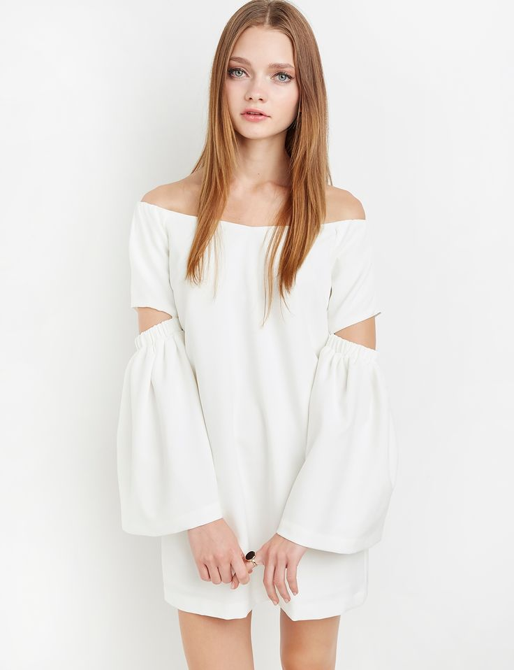 Ivory off the shoulder dress with bell sleeves and cut out elbows. Elastic  for fit.