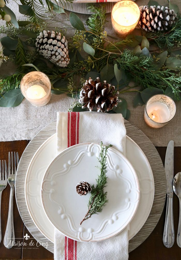 Classic Christmas Table Setting With Roses Pinecones And Greenery Holiday Table Decorations Christmas Plates Christmas Table