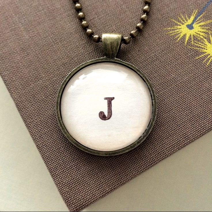 This cute custom letter necklace is on my christmas list! #book #gift #necklace #library #monogram #type #nerd