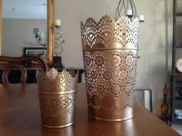 http://item2.tradesy.com/r/775fc83ee2e411695fc670b097b17a2c/355/355/weddings/other/os/ikea-skurar-lace-candle-holders-painted-gold-543651.jp...