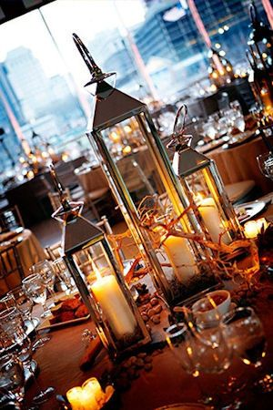 Wedding Centerpiece Ideas- lanterns of different heights. an elegant way of lighting the table but making a simple but nice centerpiece