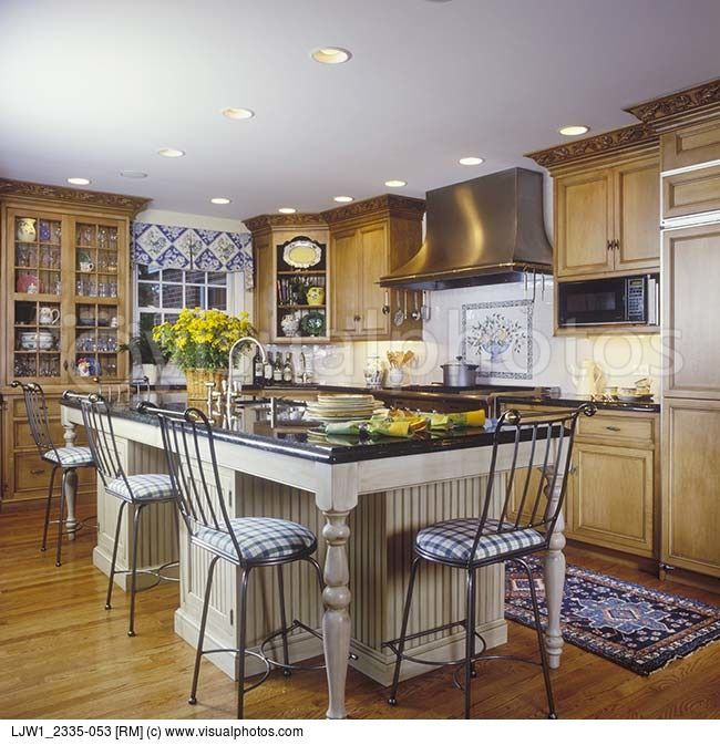 Medium Wood Kitchens: Kitchen Stained Cabinets With White Island