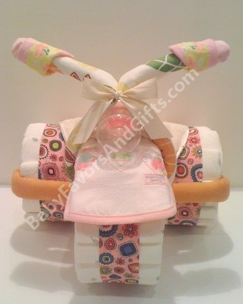 Organic Girl Tricycle Diaper Cake http://babyfavorsandgifts.com/organic-girl-tricycle-diaper-cake-p-223.html