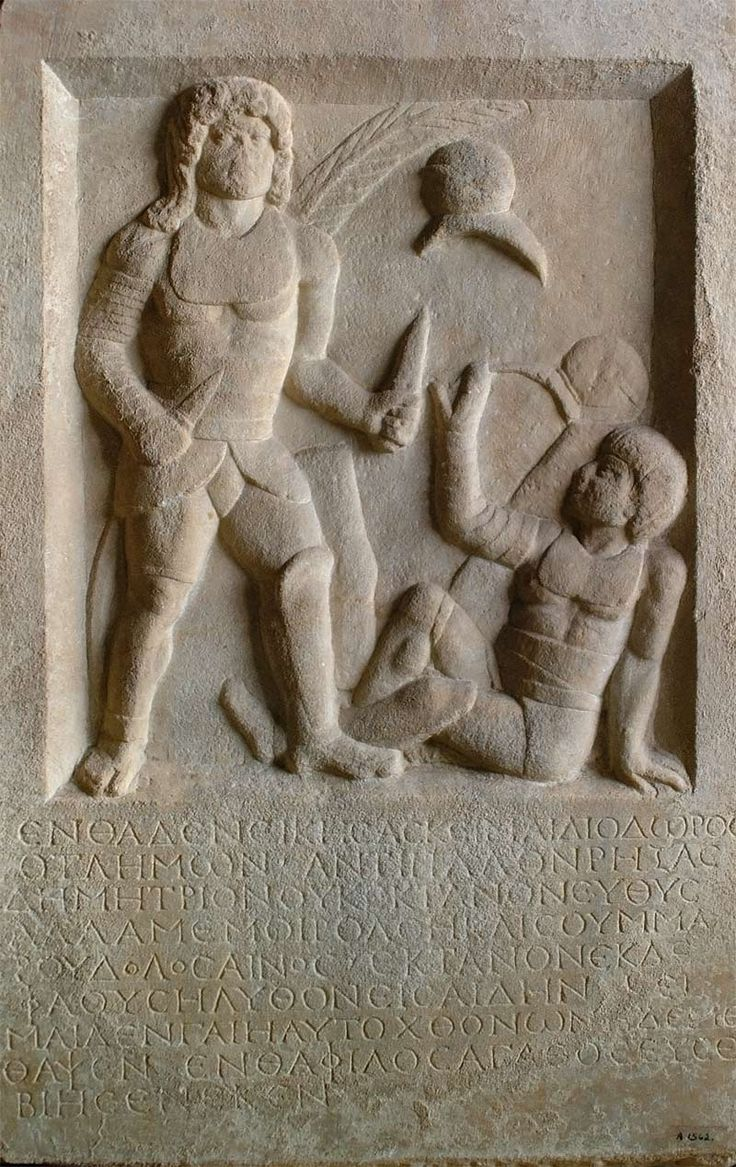 This 1,800-year-old tombstone depicts a gladiator holding two swords standing above his defeated opponent who is signalling submission. The inscription below says Diodoros, a gladiator, was buried here. _  Royal Museums of Art and History, Brussels. _