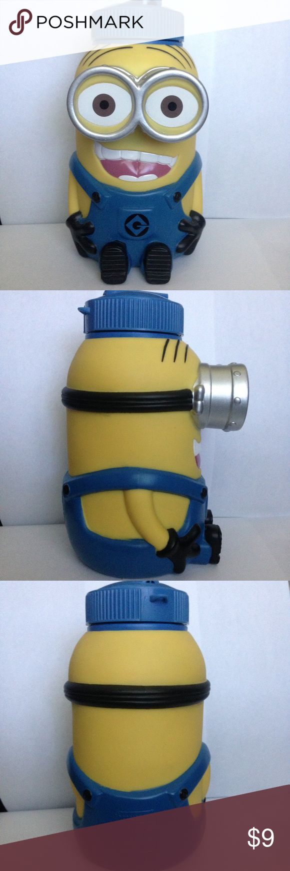 Minion Cup 8 1/2 inches tall, almost 10 inches when the straw is up. 4 1/2 inches wide from the back to the front, including the eyes. 4 inches wide from side to side (arm to arm). Bought at Universal Studios. Only used once on the day of purchase. No smell of use. Minion Other
