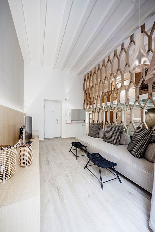 The living area is separated by a see-through dividing wall from the dining room, kitchen and bedrooms in this beautiful Italian apartment