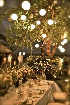 Lanterns in the trees come alight in the evening. #podwedding