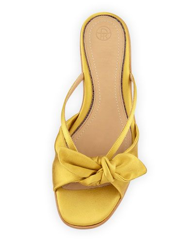 I think I'm crying out of sheer summer marigold sandal perfection. Imagine  pairing with a crisp while button down and frayed blue jean shorts?