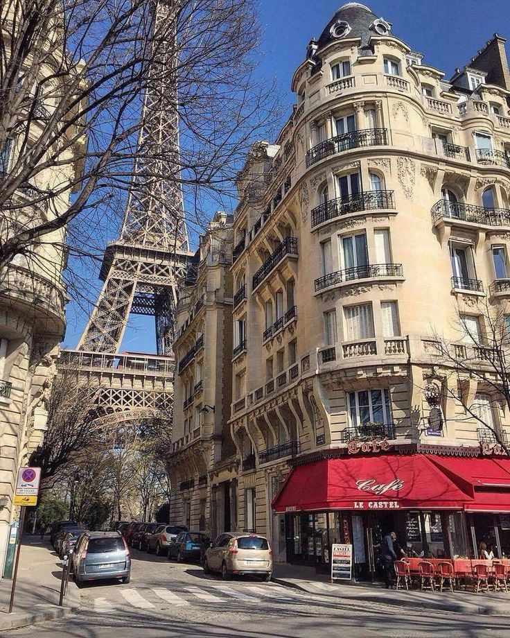 Eiffel Tower peeking from behind a cool building in Paris
