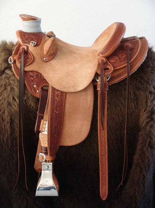 8 & 1/2 Half Breed Wade Saddle by Keith Valley   Specs: Wade tree by Rick Reed 16 inch seat Gullet - 7 & 1/2H by 6 & 1/4W by 4 93 Degree Bars Horn - 3 & 5/8ths high by 4 & 1/2 Guatelajara Cantle - 4&1/2 inches high by 12&1/2 inches wide Cheyenne Roll - 1 & 3/4 inches 7/8ths flat plate riggin Geometric Border with Sheridan Style Floral Stainless Steel Hardware - by Harwood 4&1/2 inch Monel Stirrups Santa Barbara twisted stirrup leathers Full length stirrup leathers 32 inch 100% Mohair Roper…