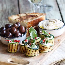 Mediterranean platter featuring Courgette rolls with Feta, Mint & Chilli