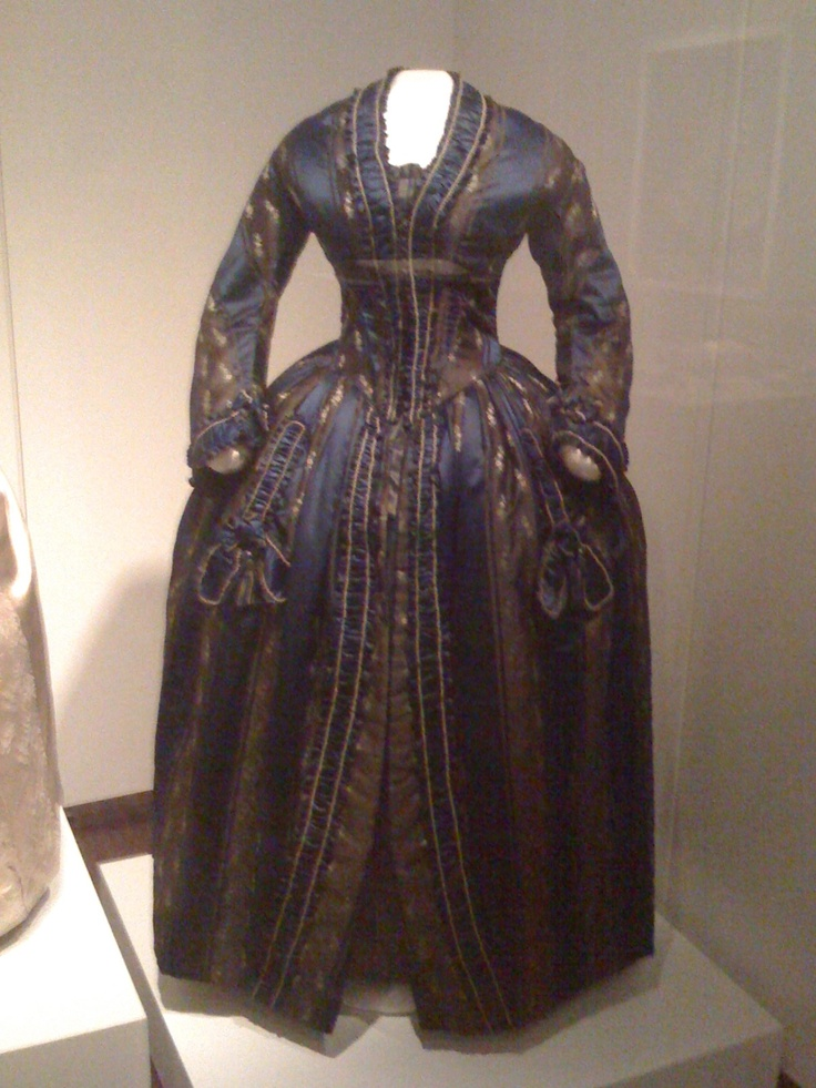 """Dress from """"Sarah Polk, First Lady of Style"""" exhibit; Columbia, TN. The exhibit states """"In 1847, she ordered the blue silk """"robe de chambre"""" (""""morning gown"""" from Madame Oudot Manoury, one of the most fashionable couturiers in Paris, France. The """"robe de chambre"""" is like a modern bathrobe, quilted inside for warmth and opening down the front.  It was an appropriate """"undress"""" costume for receiving morning visitors.  We do not know what she wore underneath (a day dress is suggested here)."""""""