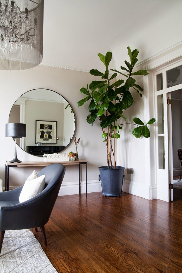 Beautiful round mirror for modern living rooms | The perfect piece for modern living rooms. The round mirror fits any kind of decor | www.bocadolobo.com #roundmirrors