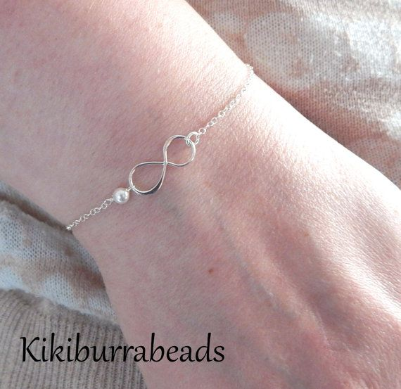 Child Infinity Bracelet With Wire Wrapped White by Kikiburrabeads Sterling silver infinity bracelet for a child. $25.00 available at www.kikiburrabeads.etsy.com