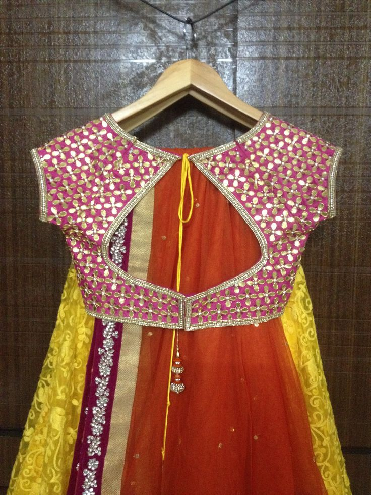 Let this outfit make your fashion statement..Stunning Lengha by Pareesa Boutique..Rich Yellow color Thread embroided net lengha fabric, with Pink raw silk gota patti blouse and orange Duppatta with velvet border..  #lehenga #choli #indian #shaadi #bridal #fashion #style #desi #designer #blouse #wedding #gorgeous #beautifu #Half Saree
