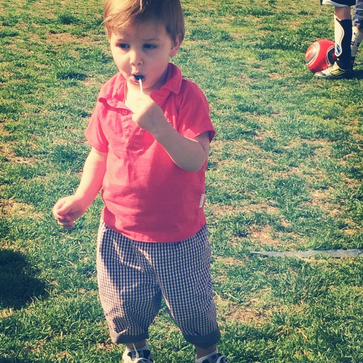 Eating a lollipop and wearing his Lucien reversible pants. Tres nonchalant!