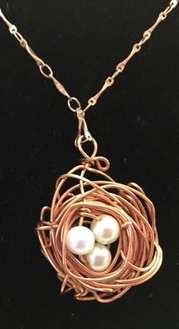 Artisan; Copper nest necklace: Three pearl bead eggs: Copper woven nest: Copper necklace