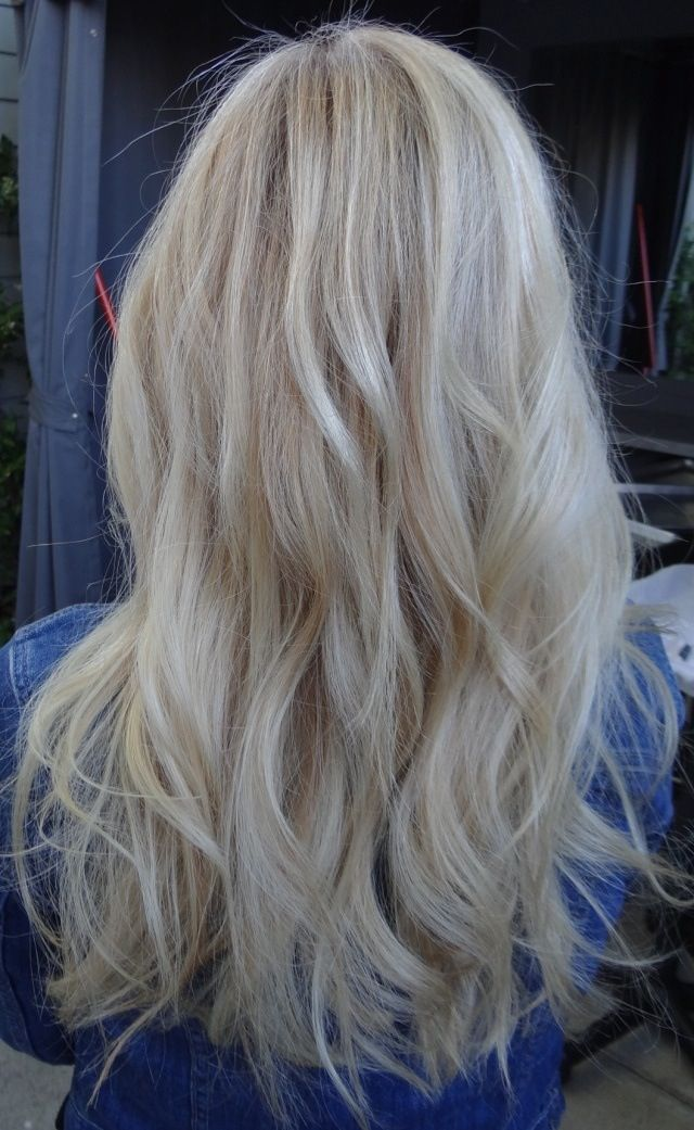 ash blonde hair in loose waves.great for summer!